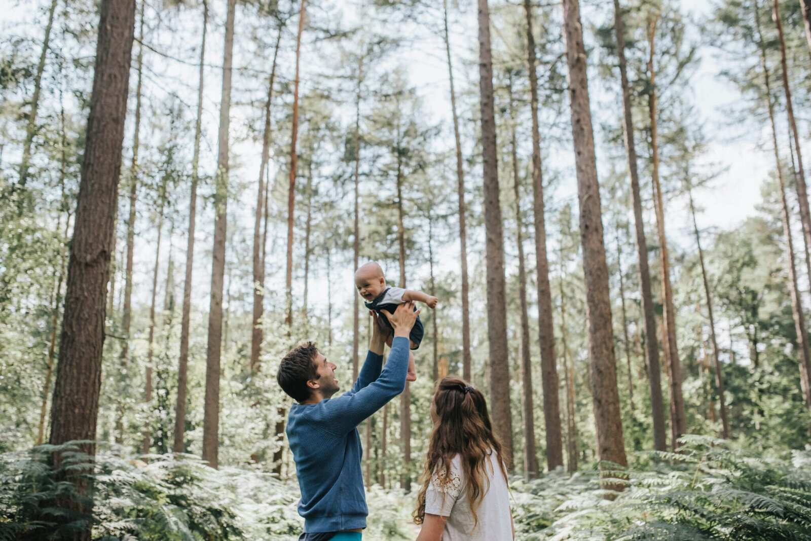 Young family playing in woods in Stamford